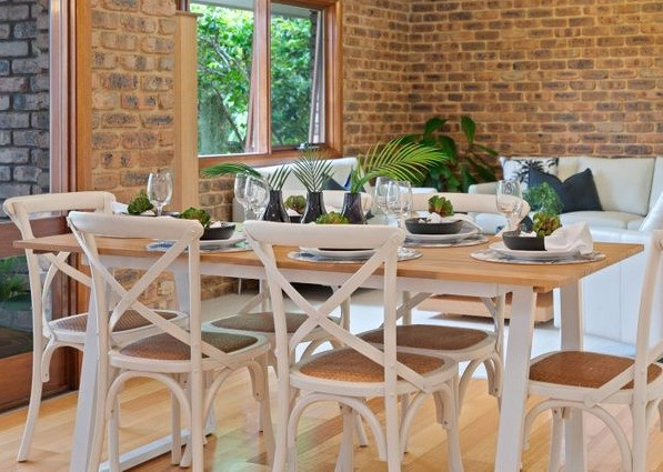 Dining table and chairs set for property staging photo shoot
