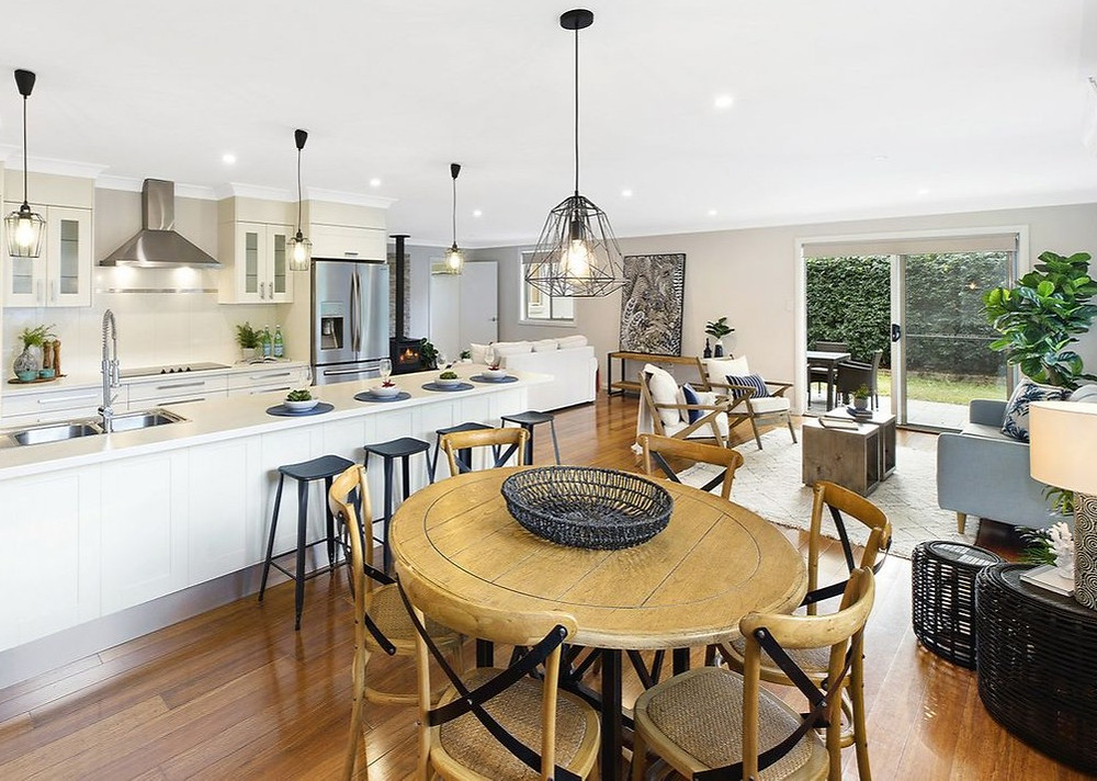 Beautiful timber dining table and chairs in foreground of a Narara property styled for sale by Home Property Styling