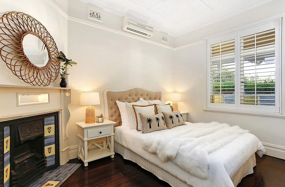 Beautifully property staging in a period semi bedroom, using queen setting, linens, side tables, lamps and headboard with venetian shutters