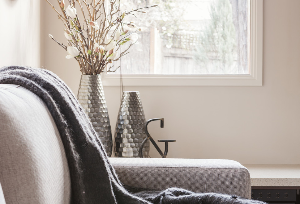 Beautiful inviting sofa with throw rug a