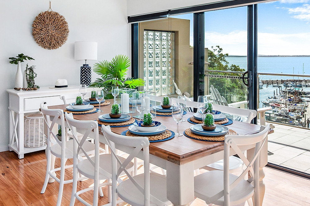 Fully set dining setting above a mariner setting in Port Stephens by Home Property Styling