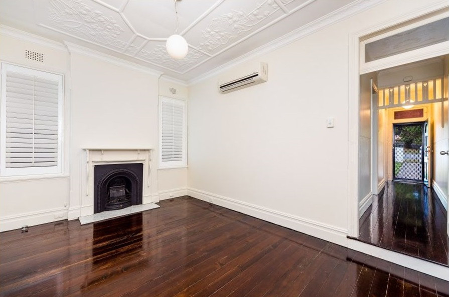 An empty lounge room before property staging
