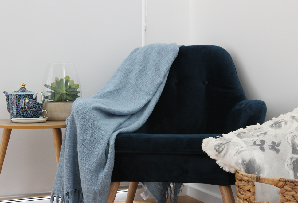 Velvet occasional chair, throw and accessories