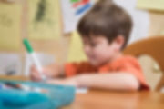 Academic Tutoring Columbus OH | Reading Comprehension Strategies | Young Student Drawing with Markers