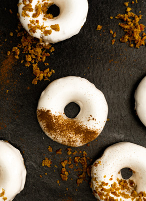 Carrot Cake Donuts with a Whipped Vanilla Frosting