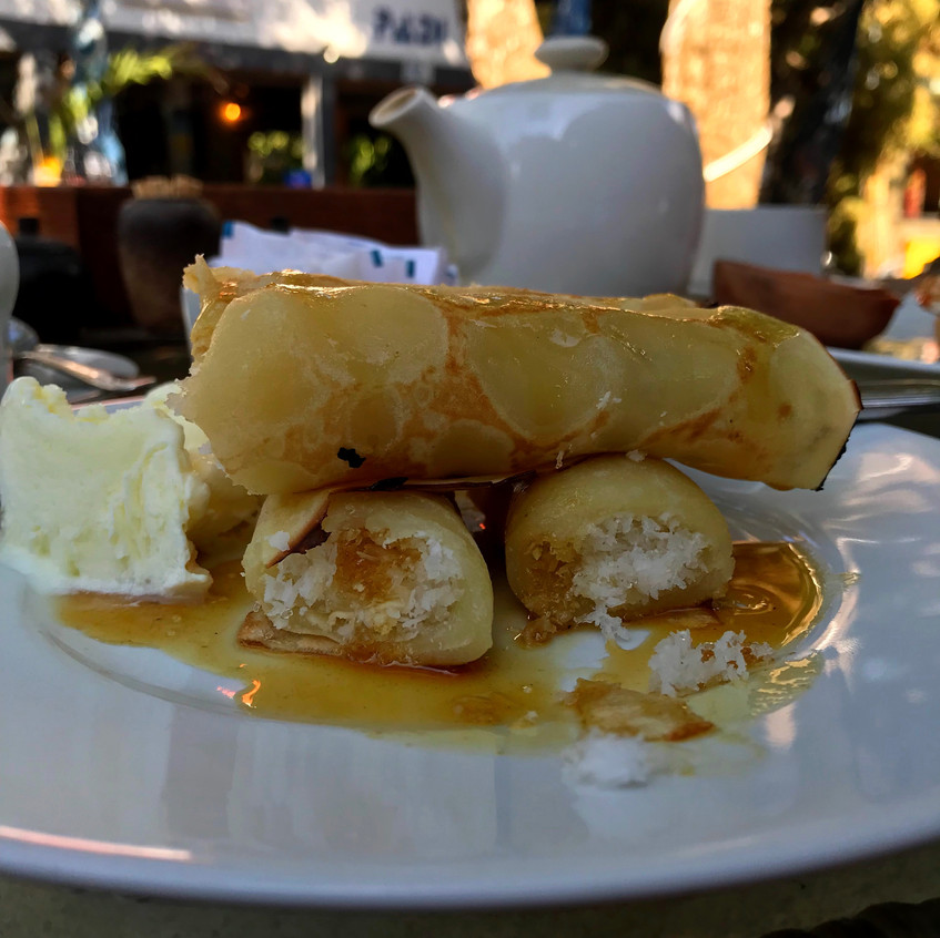 A local dish of pancakes. stuffed with candied coconut. Good for a sweet tooth!