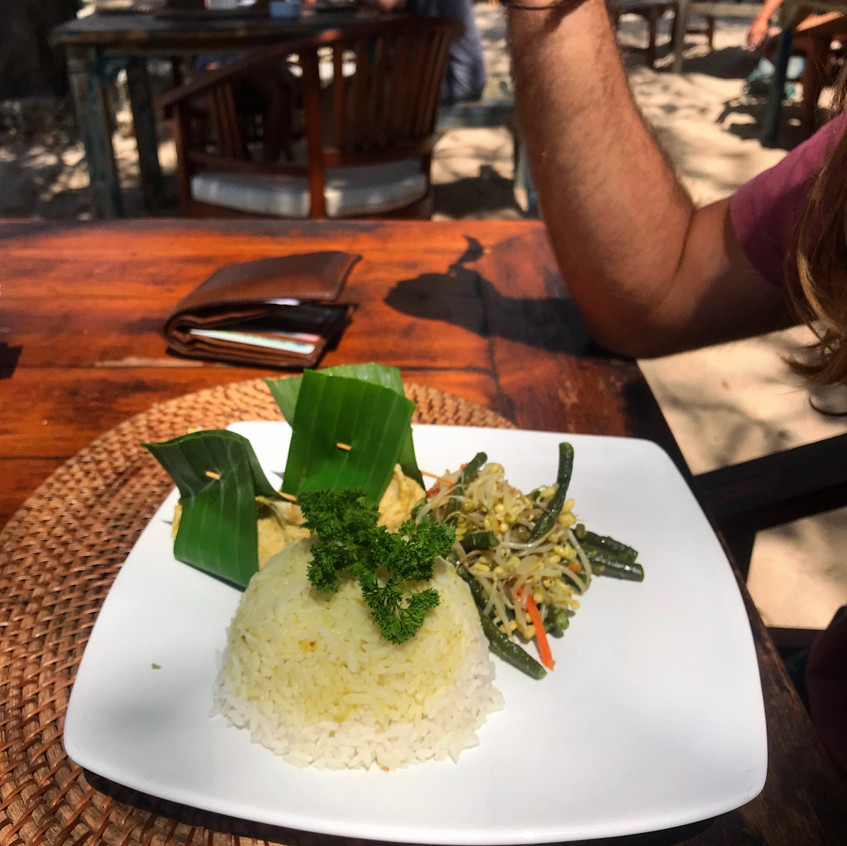 Lee's dinner, delicately presented and wrapped in banana leaves