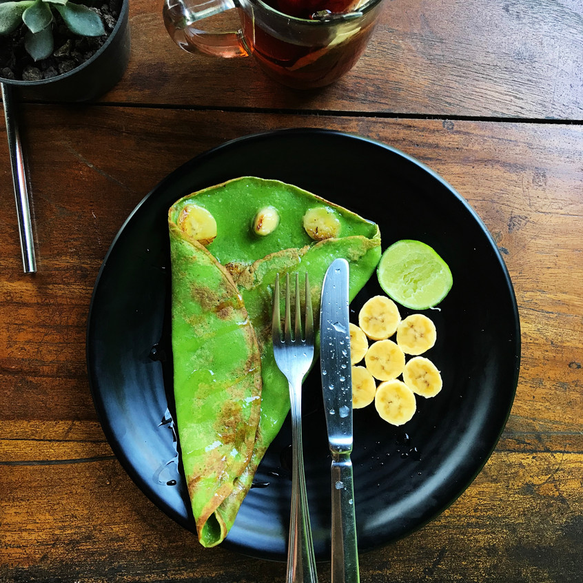 Banana pancakes, Bali style. Flavoured with Pandan, the green is genuinely completely natural.