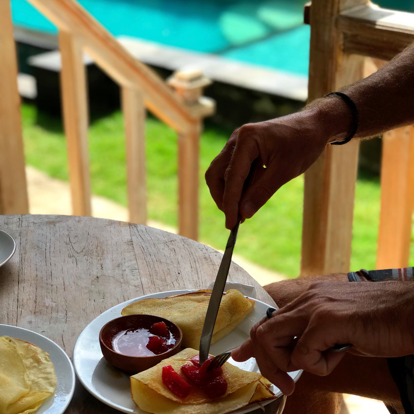 Breakfast of champion- strawberry pancakes next to the pool!
