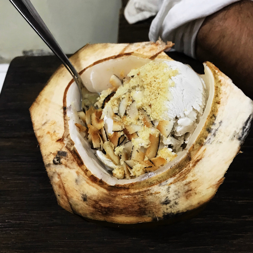 Coconut ice cream, served IN the coconut with coconut sugar, coconut flakes. YUM!