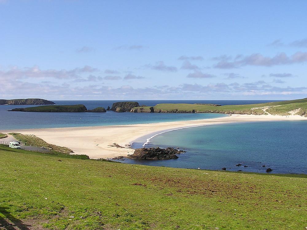 Tombolo sand bar linking St. Ninian's Isle to Mainland, Shetland.