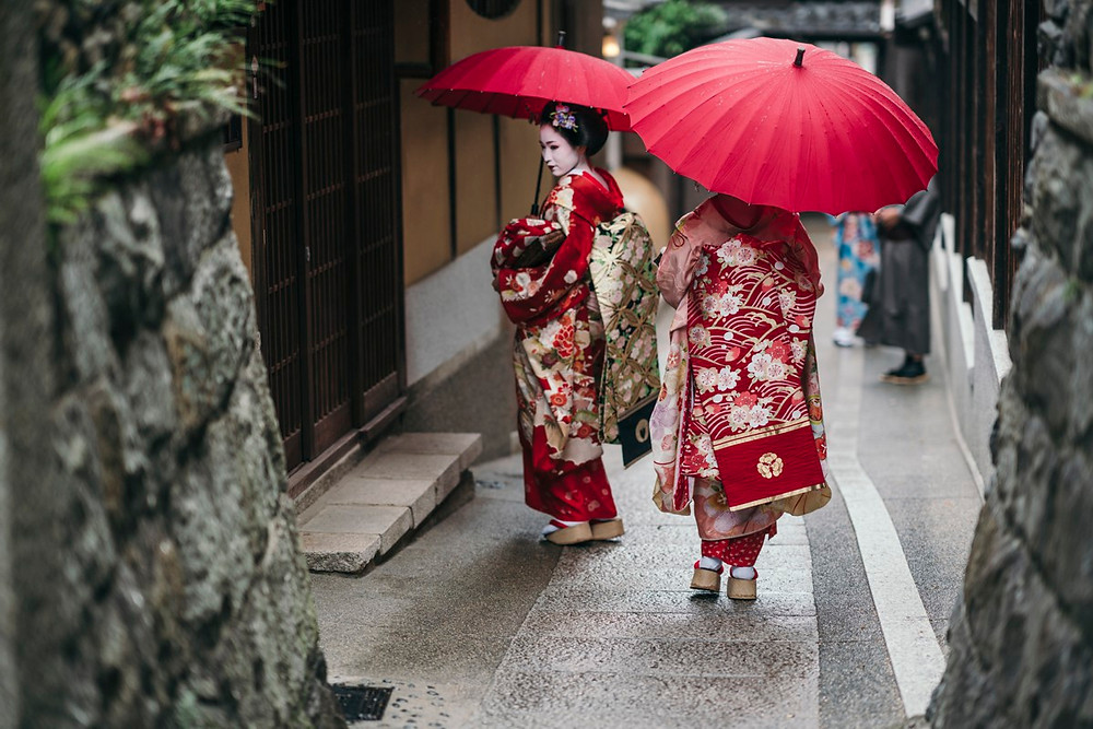 Maiko geishas walking on a street of Gion, Kyoto