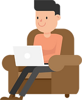 Man_Working_at_his_Laptop_on_the_Couch_C