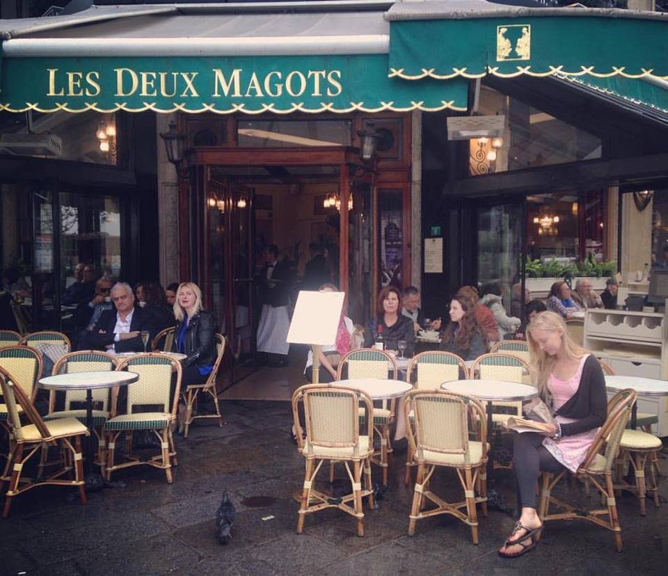 Living a writer's dream of sipping an aperitif Hemingway-style at Les Deux Magots of Paris.
