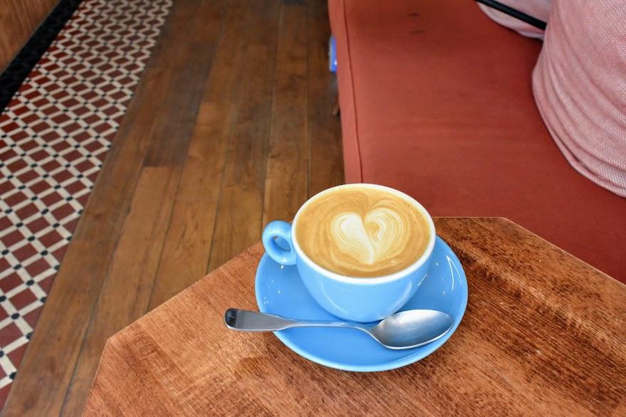 My oat milk cappuccino at Café Loustic