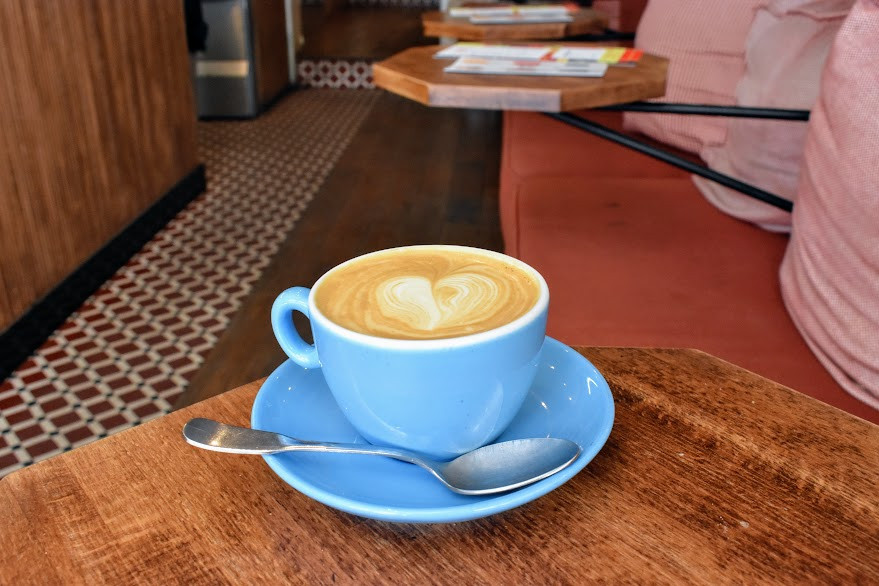 An oat milk cappuccino at Café Loustic
