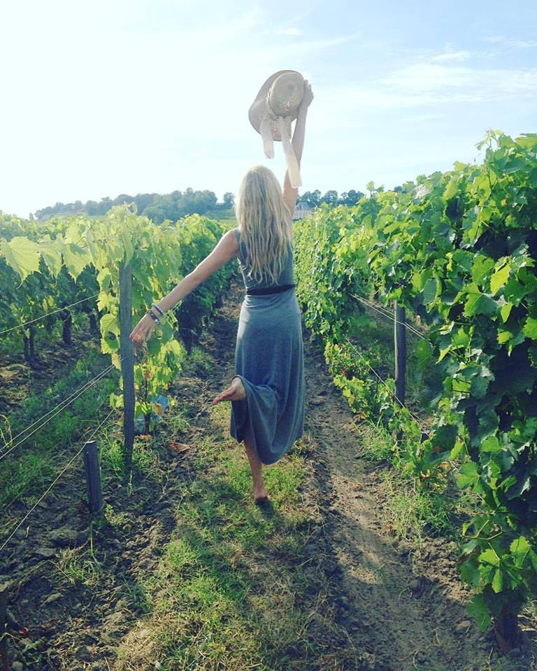 Prancing through the winegrape fields of Saint-Emilion.