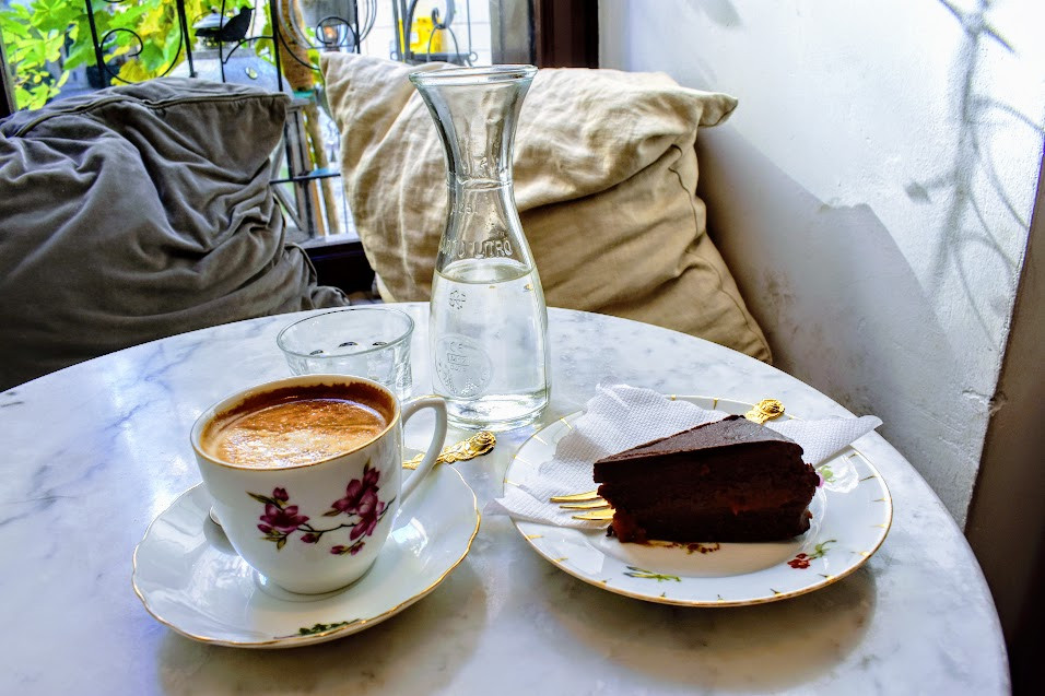 Raw Sachertorte and cappuccino at Simply Raw Bakery.