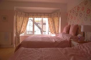 pink B and B room