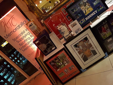 HTC Memorabilia charity auction with framed memorabilia