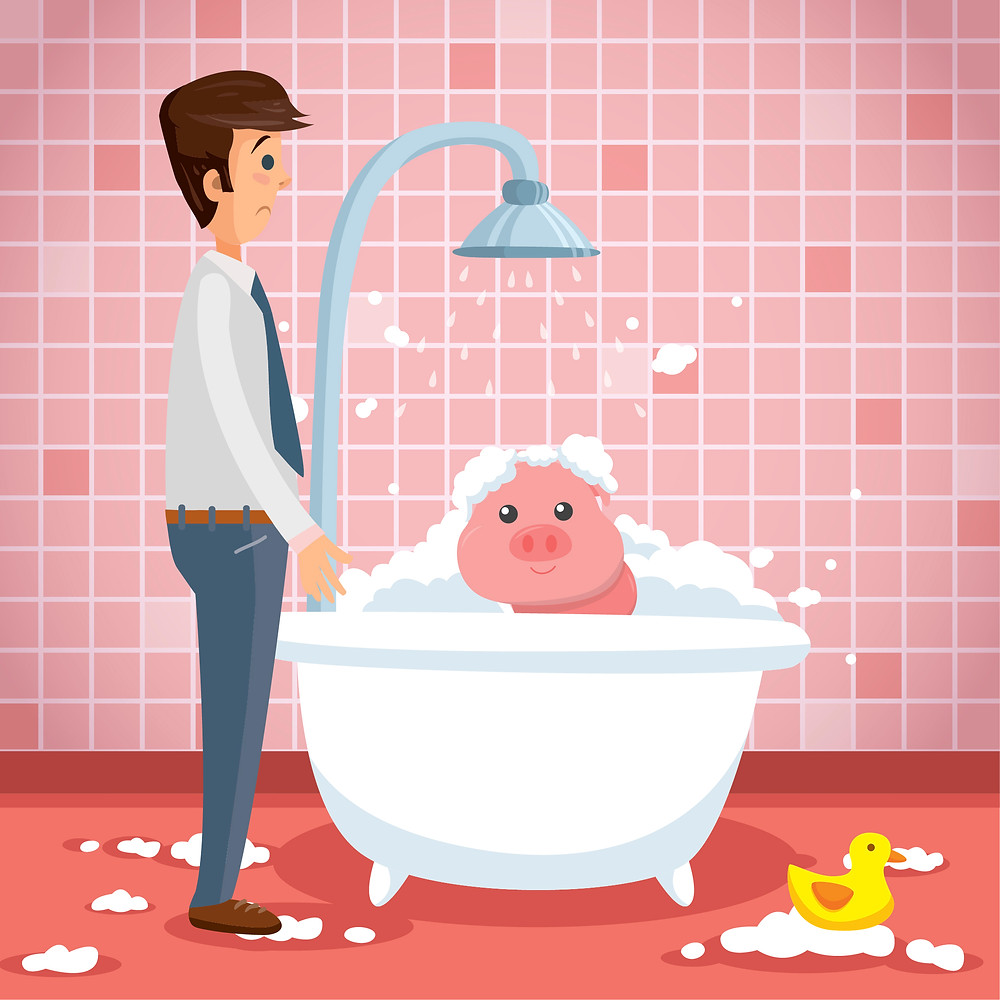 A businessman stands next to a bathtub with a pig taking a bubble bath inside.