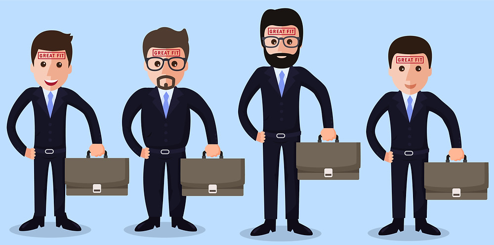 """Four businessmen of different sizes that are all dressed the same and have the words """"Great Fit"""" stamped on their foreheads."""