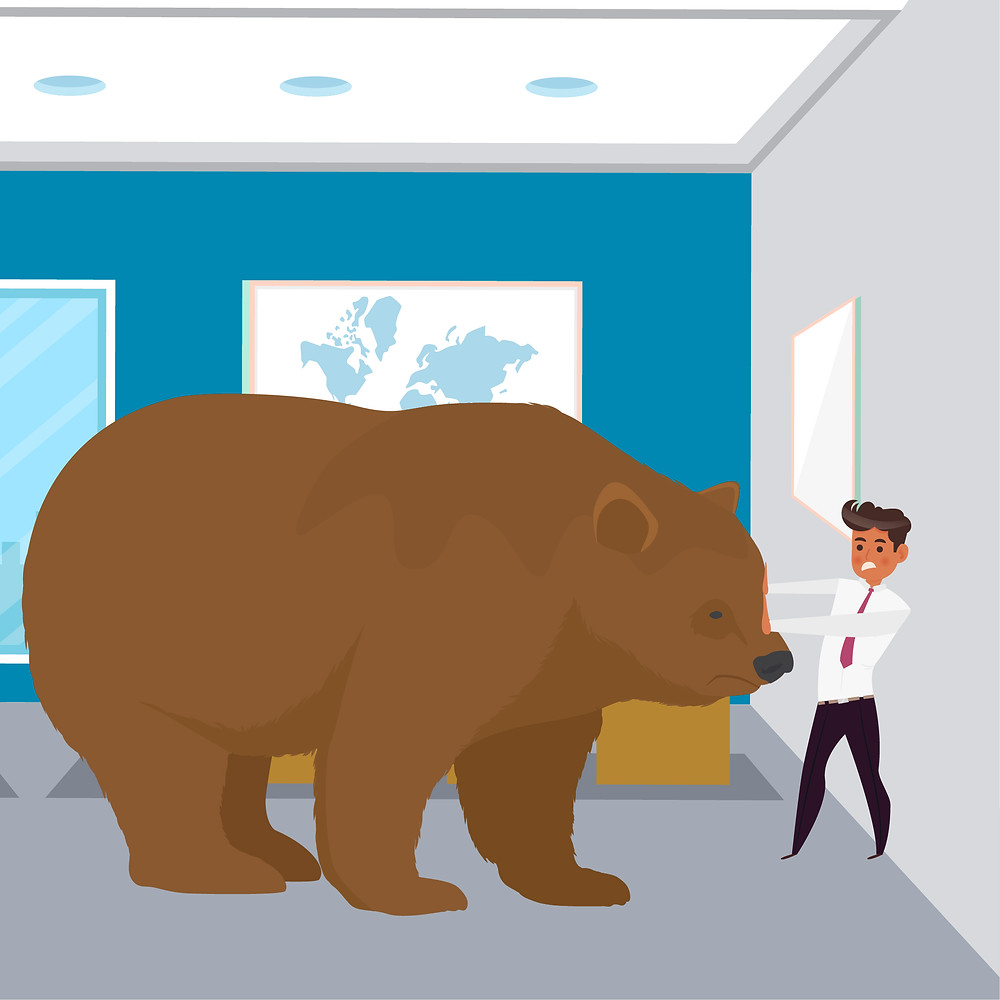 A businessman is in his office with his back against the wall as a huge bear gets closer.