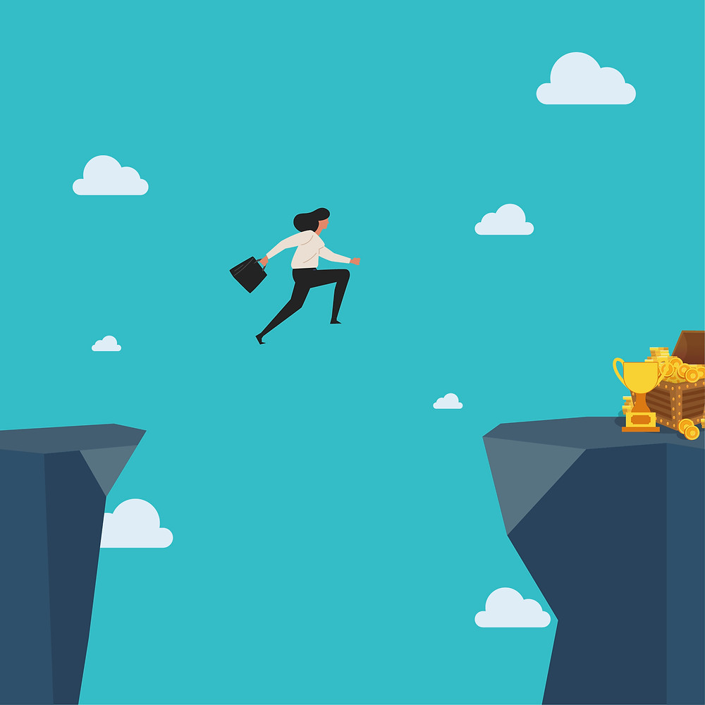 A businesswoman is shown jumping across one cliff where treasure awaits on the other side. It is not clear if she will land safely on the other side or not.