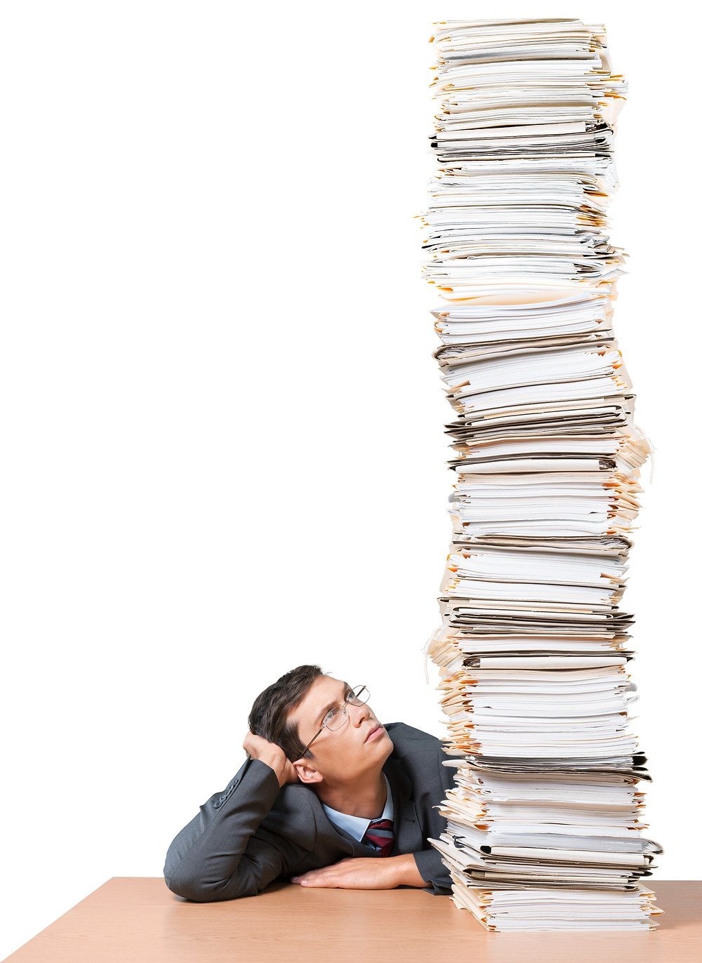 Human Resources Manager looks at a huge stack of resumes.