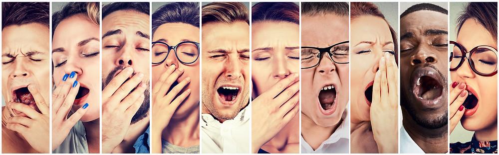 Several bored students yawning.