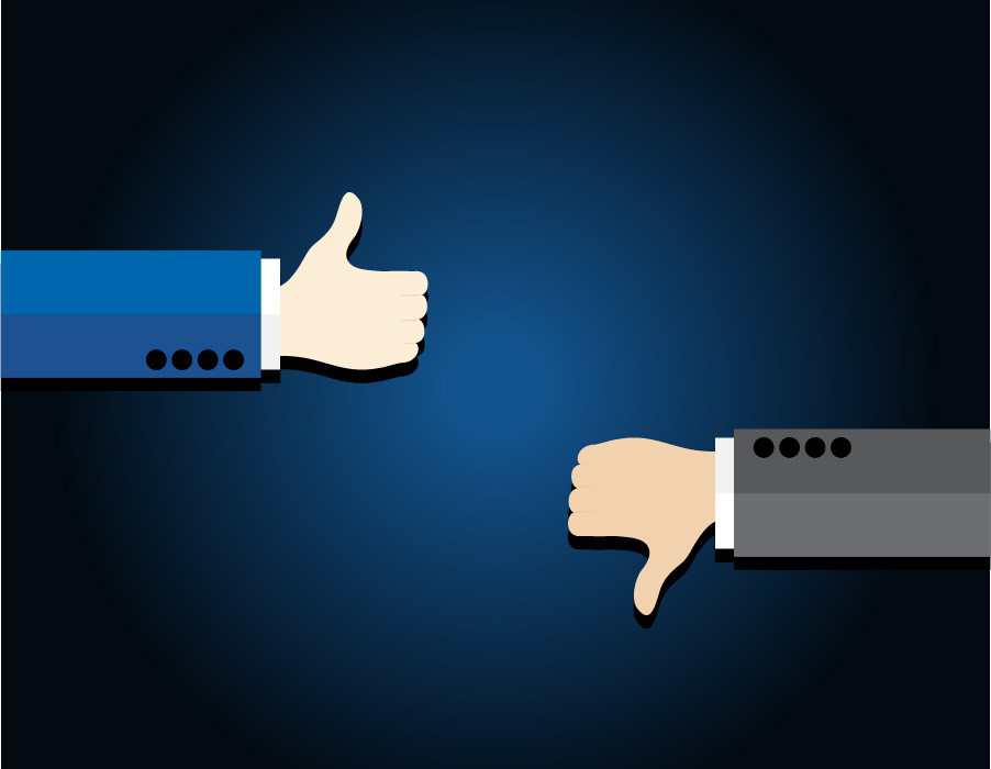 The arms of two businessmen are shown. One with a thumbs up and one with a thumbs down.