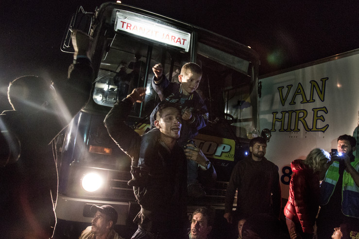 """Refugees protest in front of the buses and prevent it to take them to the """"registration camps"""". Sayings like """"no camp, no camp"""" and """"bus to germany"""" were being shouted by the refugees."""