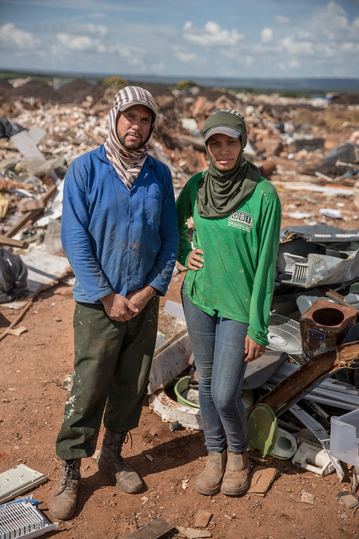 Emerson Oliveira de Souza, 31, left, and Sandra Matos, 32, right, in the Estrutural dump on Tuesday, Jan, 16, of 2018. The couple walk the path through the woods onto the dump almost every day, wearing long sleeves, baseball caps, jeans and boots. Currently they are working on the dry-waste part of the dump, but both have also worked in the dirtier, wet-waste pit.