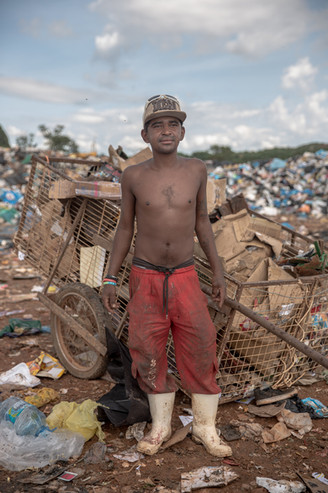 Cleiton de Jesus, 29, who has five kids, works at the Estrutural dump where he has worked since he was a kid, in Brasilia, on Monday, Jan. 15, 2018. He says his grandmother was one of the first pickers to build a little shack and live on the dump. What he makes from recycling cardboard and paper is enough to support him and his family.