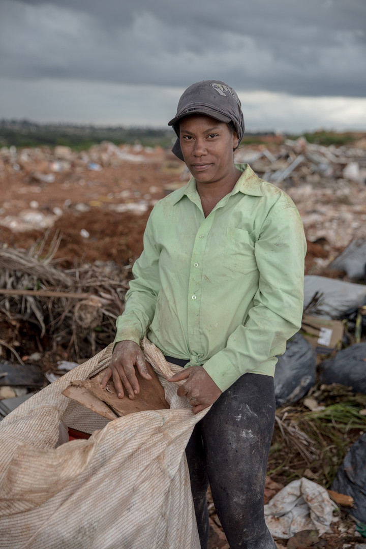 Tania Alves de Oliveira, 30, has been working for 8 years at the Estrutural dump in Brasilia, on Monday, Jan. 15, 2018. She picks metals, plastics, pipes, bottles, cardboards, among others. She has six kids and what she makes from the dump supplements her husband's income to pay the bills.