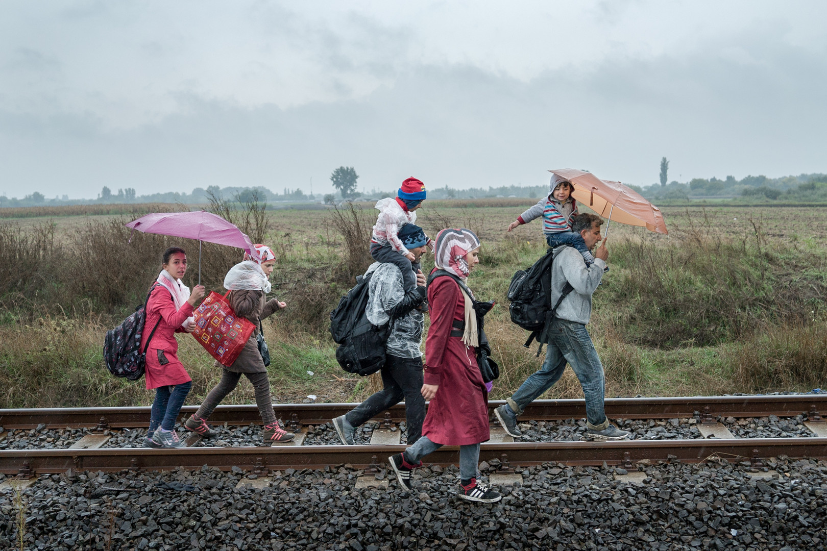 Family crossing the border of Hungary with Serbia.