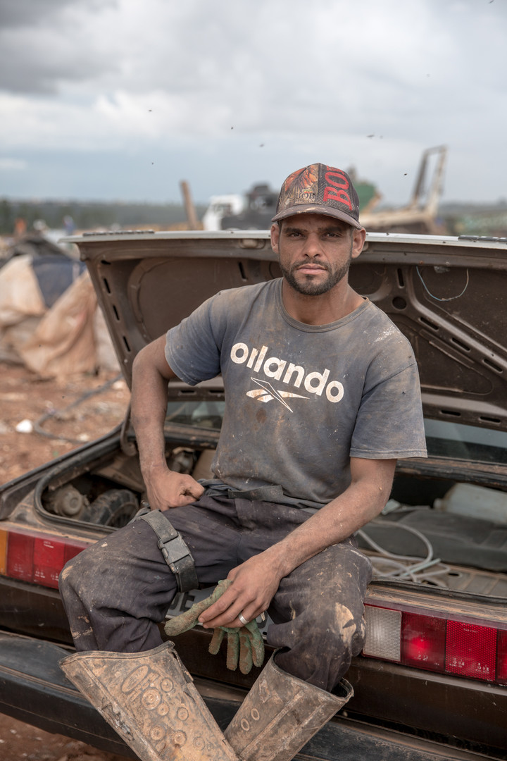 """""""I started to come here when I was five, with my grandmother"""" says Cleiton Carlos Silva, 33, at the Estrutural dump in Brasilia, on Monday, Jan. 15, 2018. Mr. Silva makes art from items he finds at the dump, like chairs and picture frames. He makes very little money from it and earns more from the trash he recycles."""