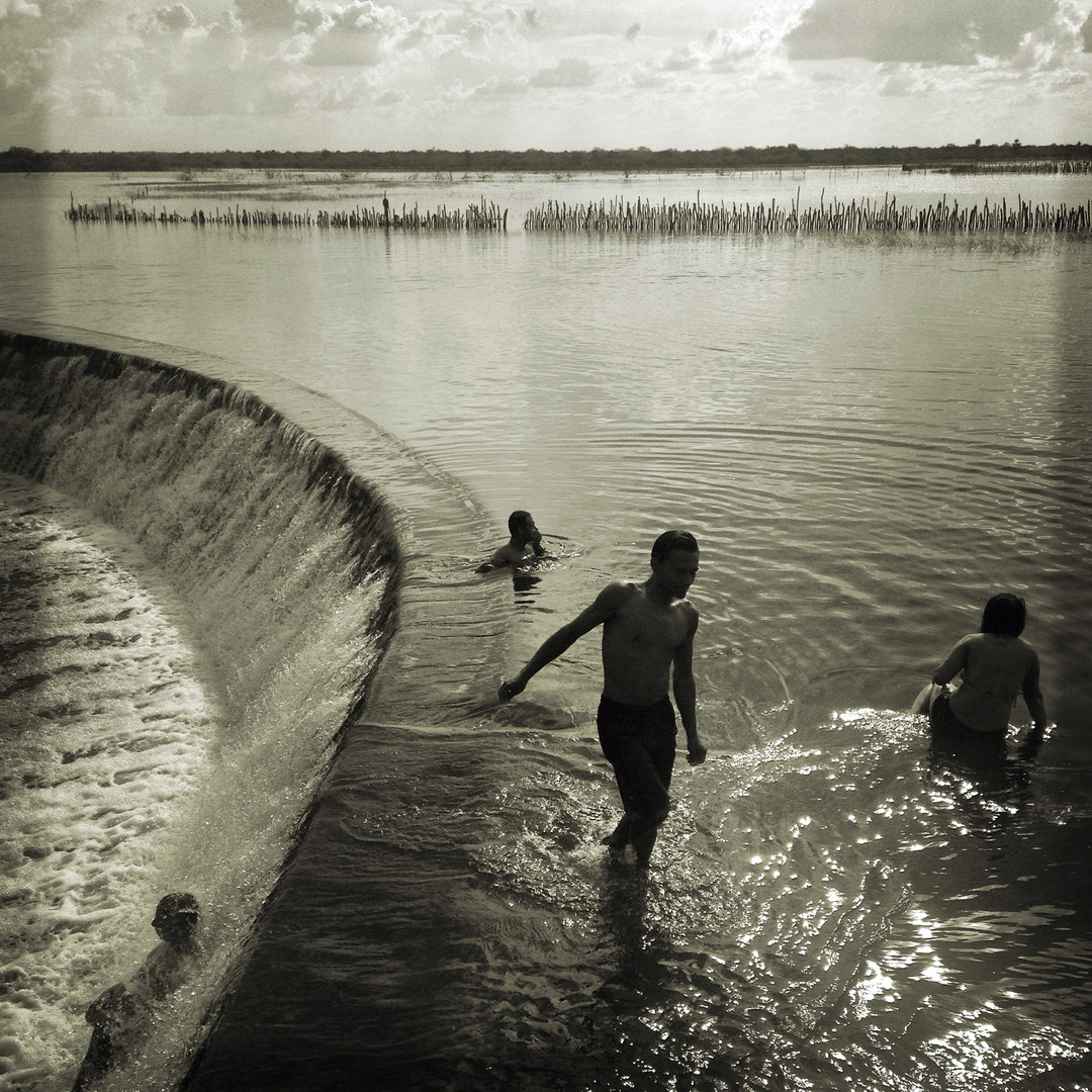 Youth play in a flood canal that flows into the São Francisco River. The region received rains for the first time in six years in January and February 2016 creating floods around villages and overflowing canals. The Sertão has been stricken with the worst drought in about 50 years.