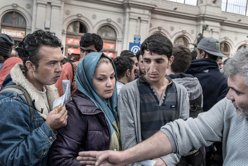 Refugees queuing to board on trains to Vienna, Austria.