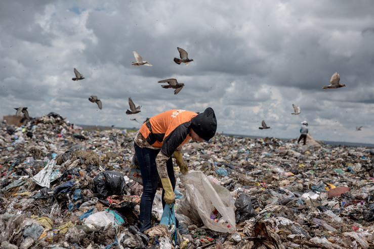 """Patricia Jordania, 26, picks bottles at the Estrutural dump in Brasilia, on Monday, Jan. 15, 2018. Ms. Jordania, from Pernambuco state, in Brazil's northeast region, moved two-years-ago with her parents to Brasilia. """"If it closes? If I don't get a job I'll go back to Pernambuco, but I want to stay, here it's easier"""". What Ms. Jordania earns at the dump supports her two unemployed parents and her three-year-old niece."""