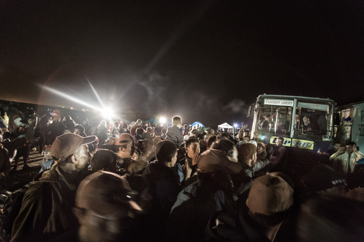 "Large group of refugees try to board in the buses that would take them to a ""registration camp"" in Roszke, Hungary."