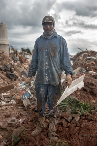Anisio Pereira Soares Filho, 35, who has worked at the dump for seven years, is a painter but he earns more money as a picker, at the Estrutural dump in Brasilia, on Monday, Jan. 15, 2018.