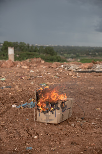 A cardboard box is burned at the Estrutural dump in Brasilia. The dump is surrounded by the Estrutural neighborhood, where 35,000 people live. Estrutural, the largest waste dump in Latin America is shutting down in Brasilia for sanitary reasons, upending the livelihood of thousands of garbage recyclers.
