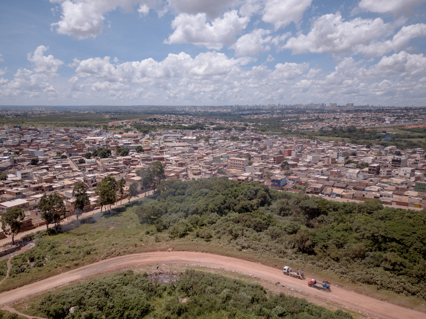 A road frequently used by the trucks of the dump and in the background, the Estrutural neighborhood, in Brasília, on Wednesday, 17 Jan, of 2018. Estrutural neighborhood is home to 35,000 residents.