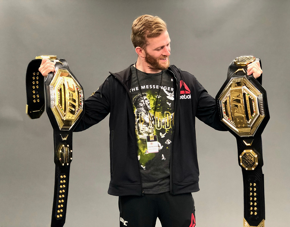 Here I hold both of Henry Cejudo's UFC belts after his victory over Marlon Moraes.