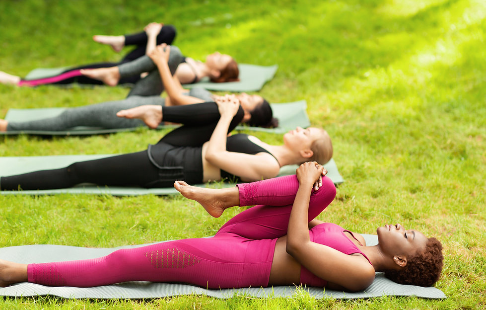 Group of diverse girls stretching their