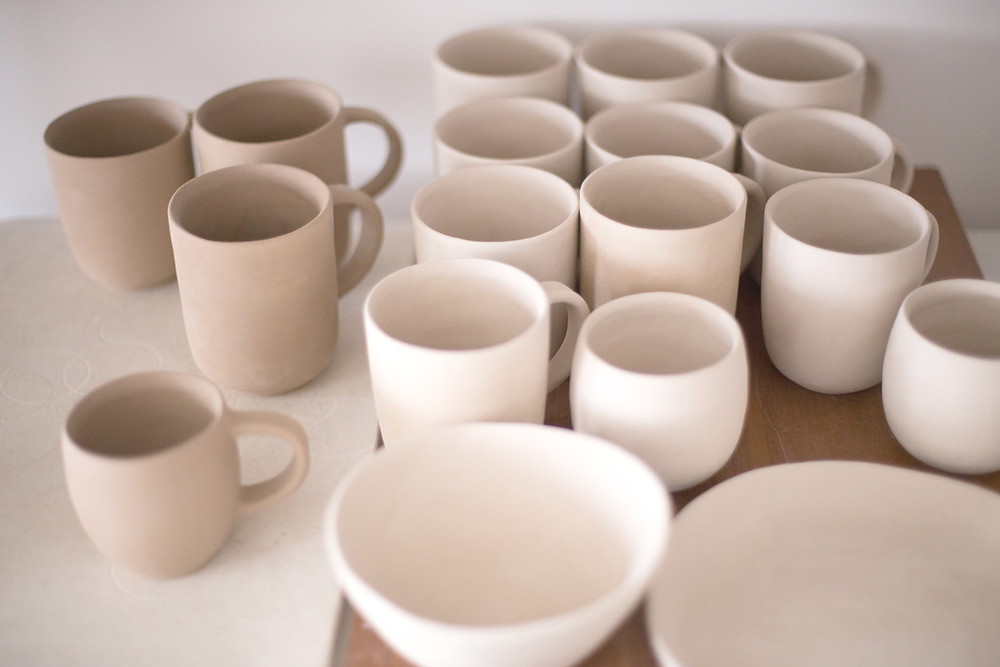 neutral cream and beige ceramic cups and bowls