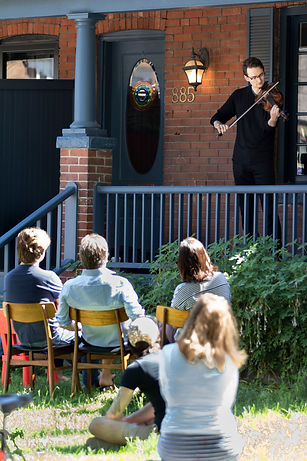 a violist plays a concert on a porch