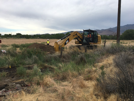 Excavating to Collect Soil Samples at the Oil Pit