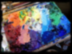 The many colors of paint on my palette.